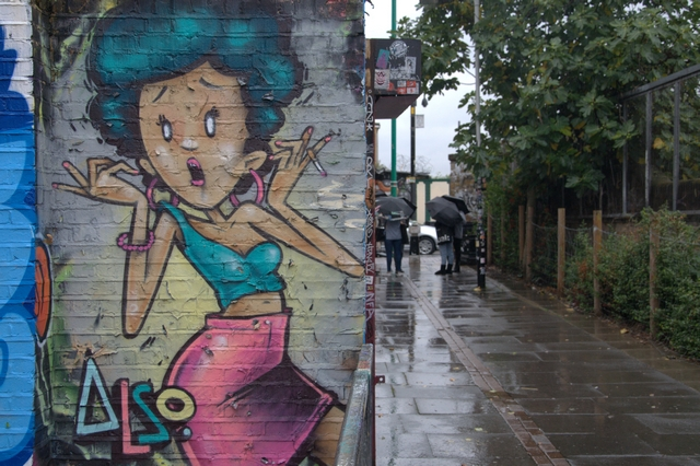 London, street art, tours, walks, weather, rain, umbrella, skimpy dress, crop top,