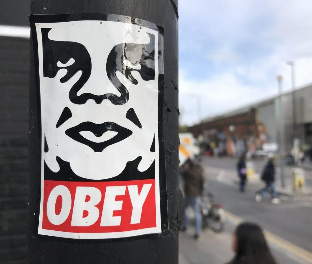 Shepard Fairey Obey Giant sticker in shoreditch