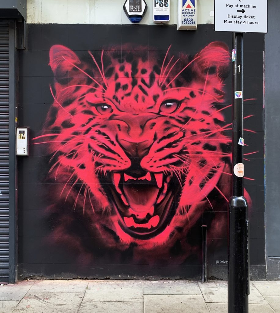 Pink neon snarling tiger in Shoreditch painted by street artist David Speed