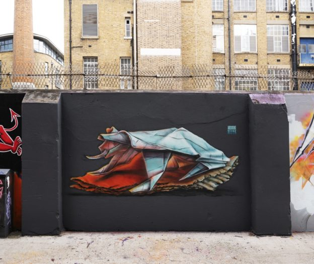 wall in shoreditch with street art origami frog painted by Airborne Mark